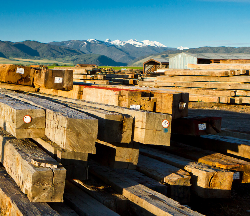 A photo of specialty timbers stacked in our extensive reclaimed lumber yard.