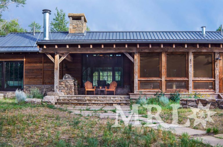 A photo of our reclaimed hand-hewn timbers and paneling along with rafter stock siding and paneling both inside and out of this Grazing Pastures project.