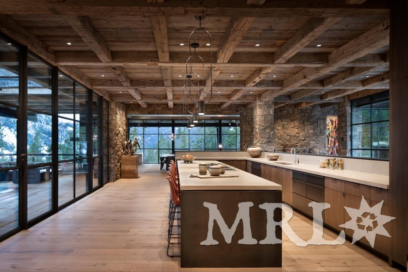 A photo featuring antique hand hewn timbers and slabs, corral board, and reclaimed oak throughout the Wits End project.