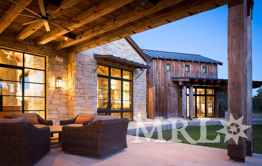 A photo of our antique barnboard, vintage rafter stock, corral board, and century-old hand-hewn beams that make up everything from the timber package and siding to the cabinetry and doors in the Glensprings Ranch project.