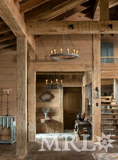 A photo of reclaimed hand hewn timbers and siding along with antique oak flooring featured throughout the Eglise View project.