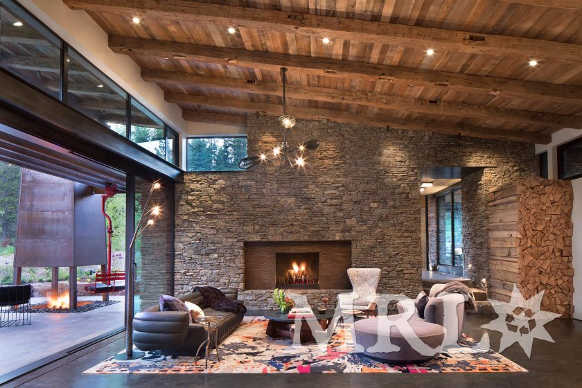 A photo featuring reclaimed oak ceiling paneling, hand-hewn timbers, and corral board siding throughout the Ross Peak Ranch project.