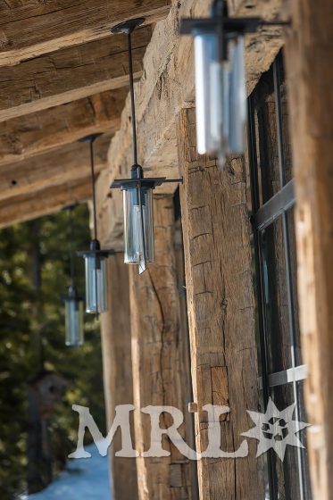 A photo showing reclaimed oak paneling and hand hewn timbers in the Camp Run-a-Muck project.