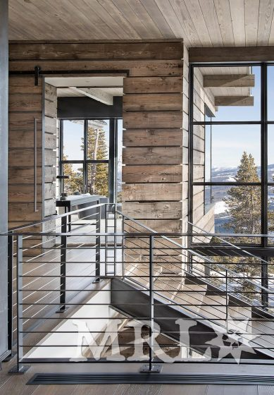 A photo featuring reclaimed gray cladding and timbers throughout the Amethyst project.