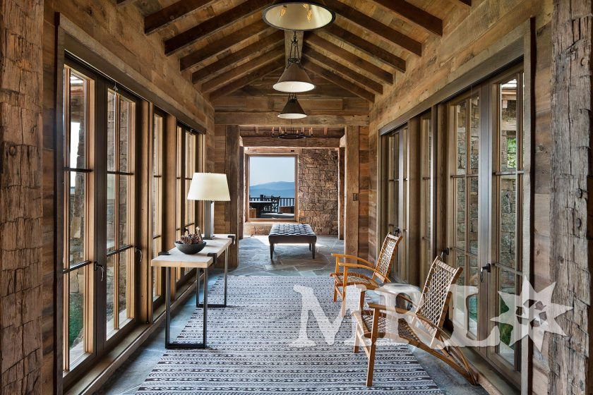 A photo featuring re-sawn antique oak floors, hand-hewn timbers, corral board cladding, rafter stock rafters and barnboard ceilings in the Andesite Family Lodge project.