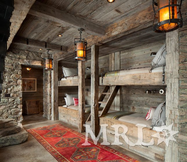 A photo of our reclaimed hand hewn beams and corral board featured throughout the Andesite Ridge project.