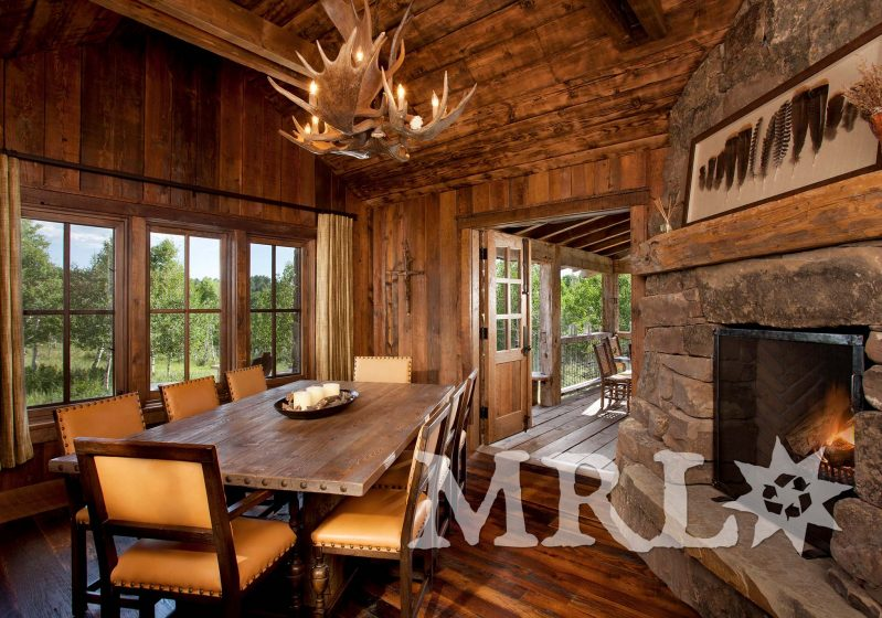 A photo of our reclaimed timber, rafter stock, barn board, corral board, and hand hewn beams featured in The Aspens project.
