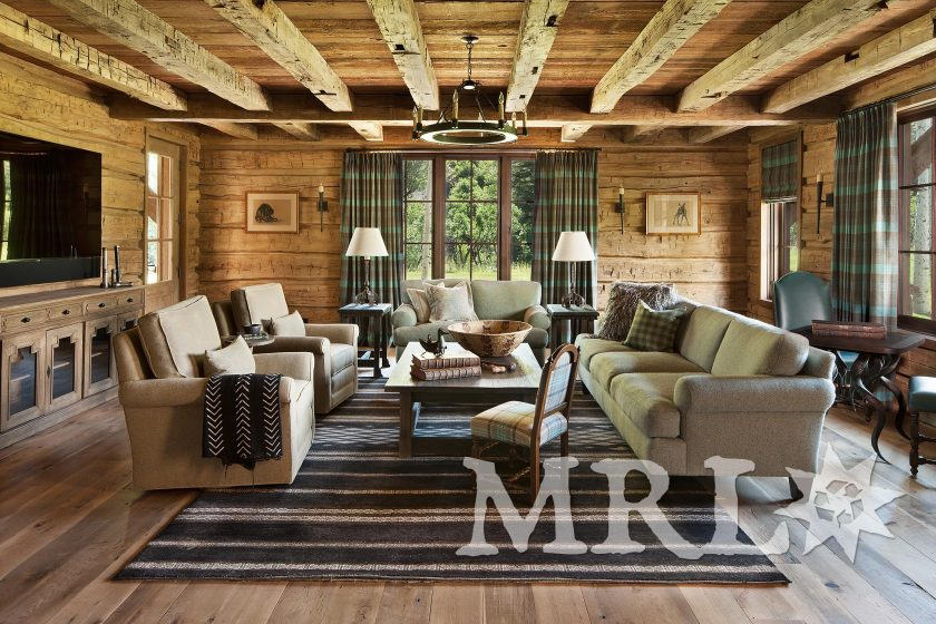 A photo of MRL's reclaimed hand-hewn timbers and siding, oak wall paneling, trim, and flooring and rafter stock clad ceilings in the Charlie Mountain project.