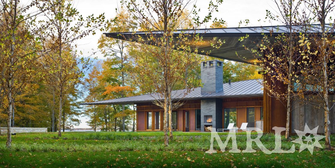 A photo of reclaimed corral board siding, garage doors, and soffit featured in the East Coast Modern project.
