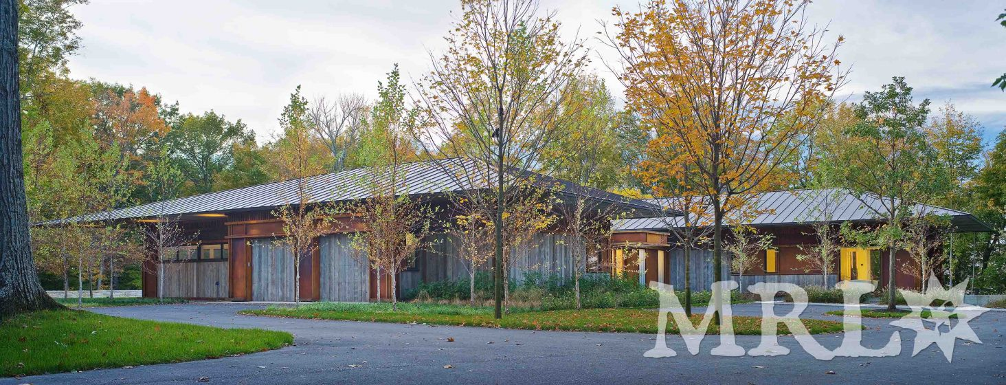 A photo of corral board siding, garage doors, and soffit featured in the East Coast Modern project.