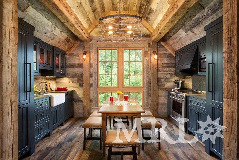 A photo showcasing our reclaimed corral board, barn board, hand-hewn beams and antique Douglas fir timbers in the Lake Country Retreat project.