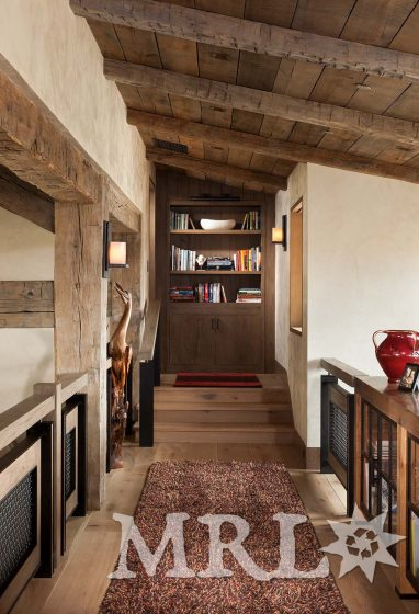 A photo of our oak ceiling paneling and hand-hewn timbers inside and out of the Legacy Ranch project.
