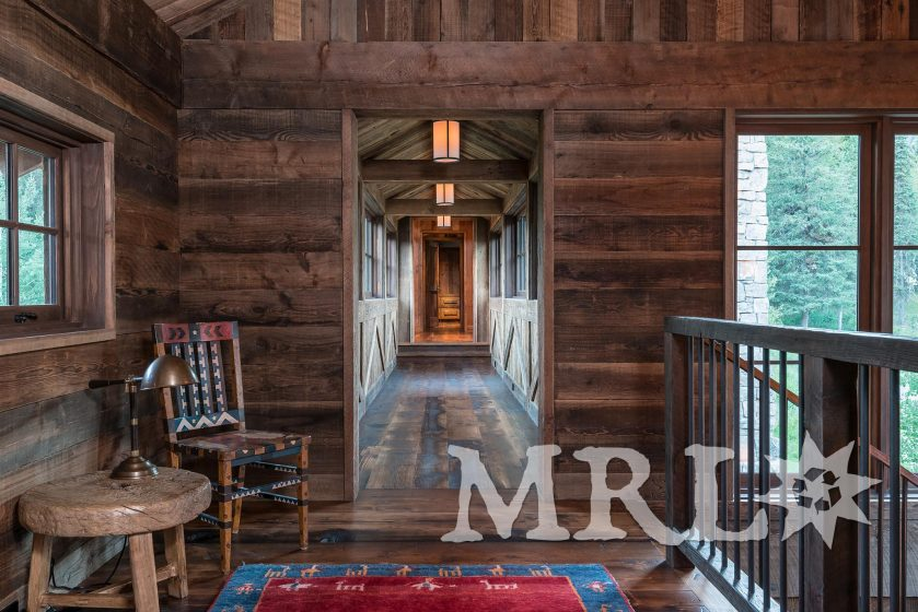 A photo of our reclaimed timbers, corral board and rafter stock siding and paneling throughout this Phillips Ridge project.