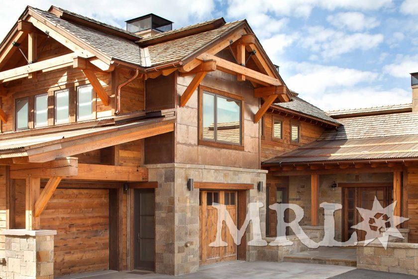"""A photo of our reclaimed, re-sawn Douglas Fir """"structural sticks"""" timbers paired with rafter stock siding in the Talus View project."""