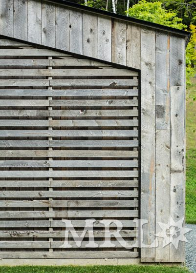 A photo of reclaimed corral board siding and interior paneling throughout the Woodshed project.